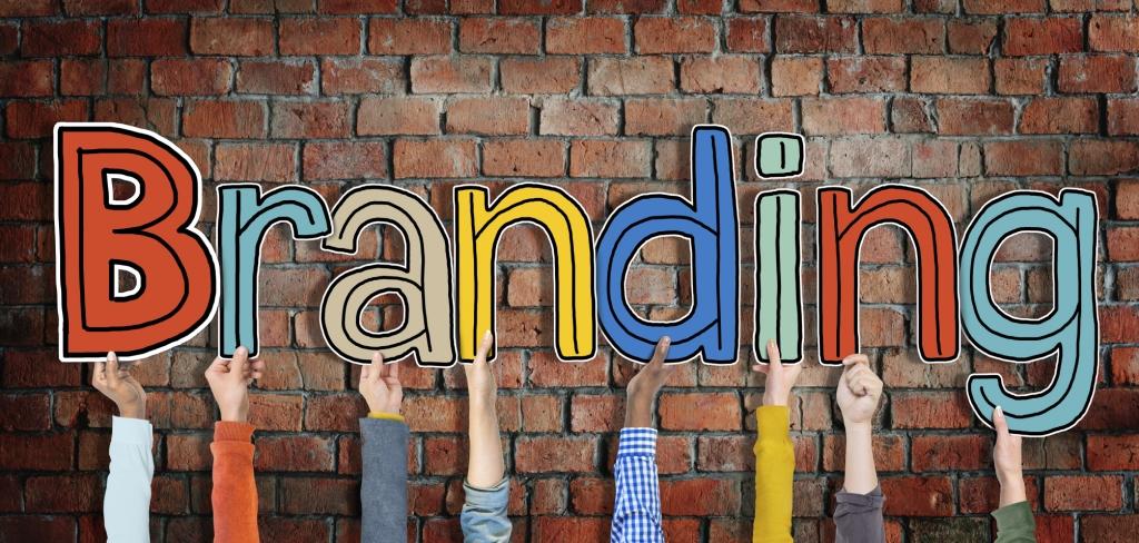 Multiethnic Group of Hands Holding Word Branding - concorrência